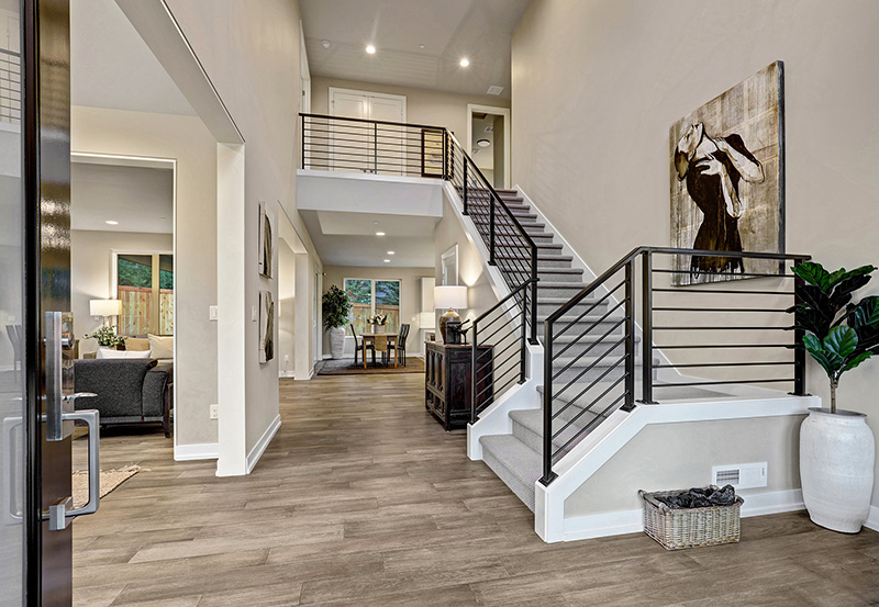 Entry with open floor plan and stairs