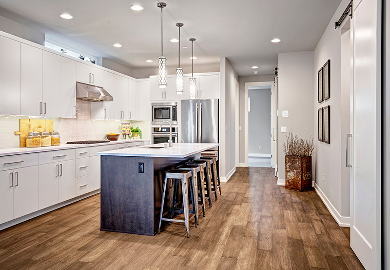 Kitchen hallway with hardwood flooring