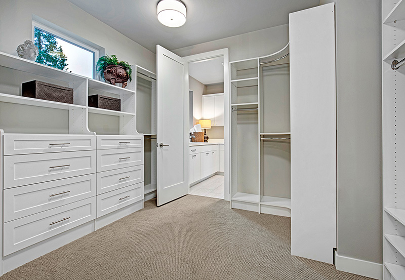 Master Walk In Closet with shelving and drawers