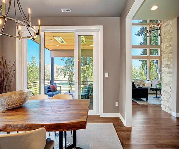 dining room sliding glass doors and living room windows