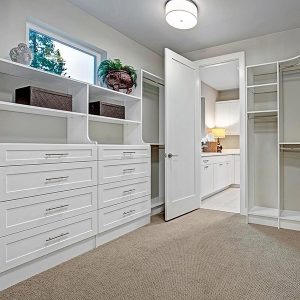master closet game changer connected to bathroom and laundry room
